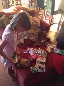 Hannah opening Christmas gifts 2015